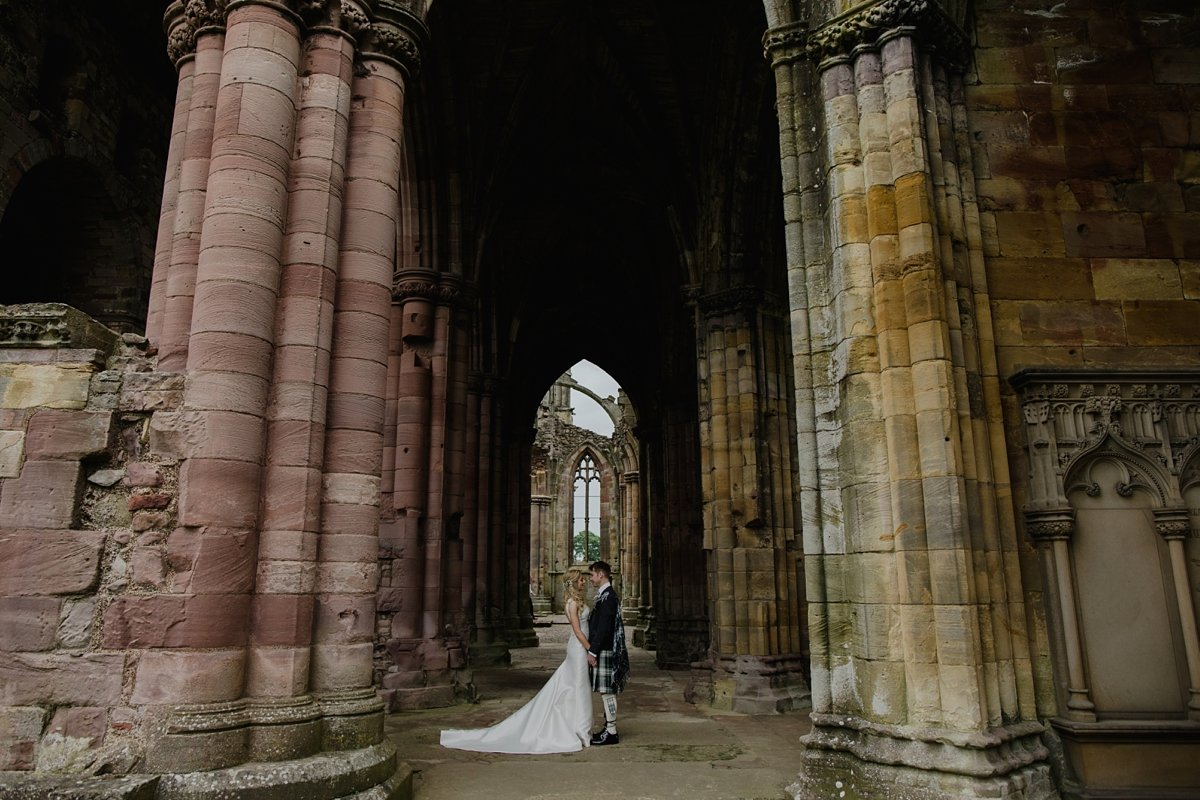 bride and groom at their melrose abbey wedding