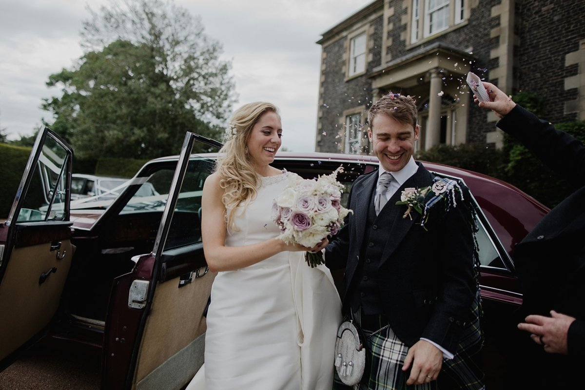 confetti for the wedding couple after arrival in the vintage car