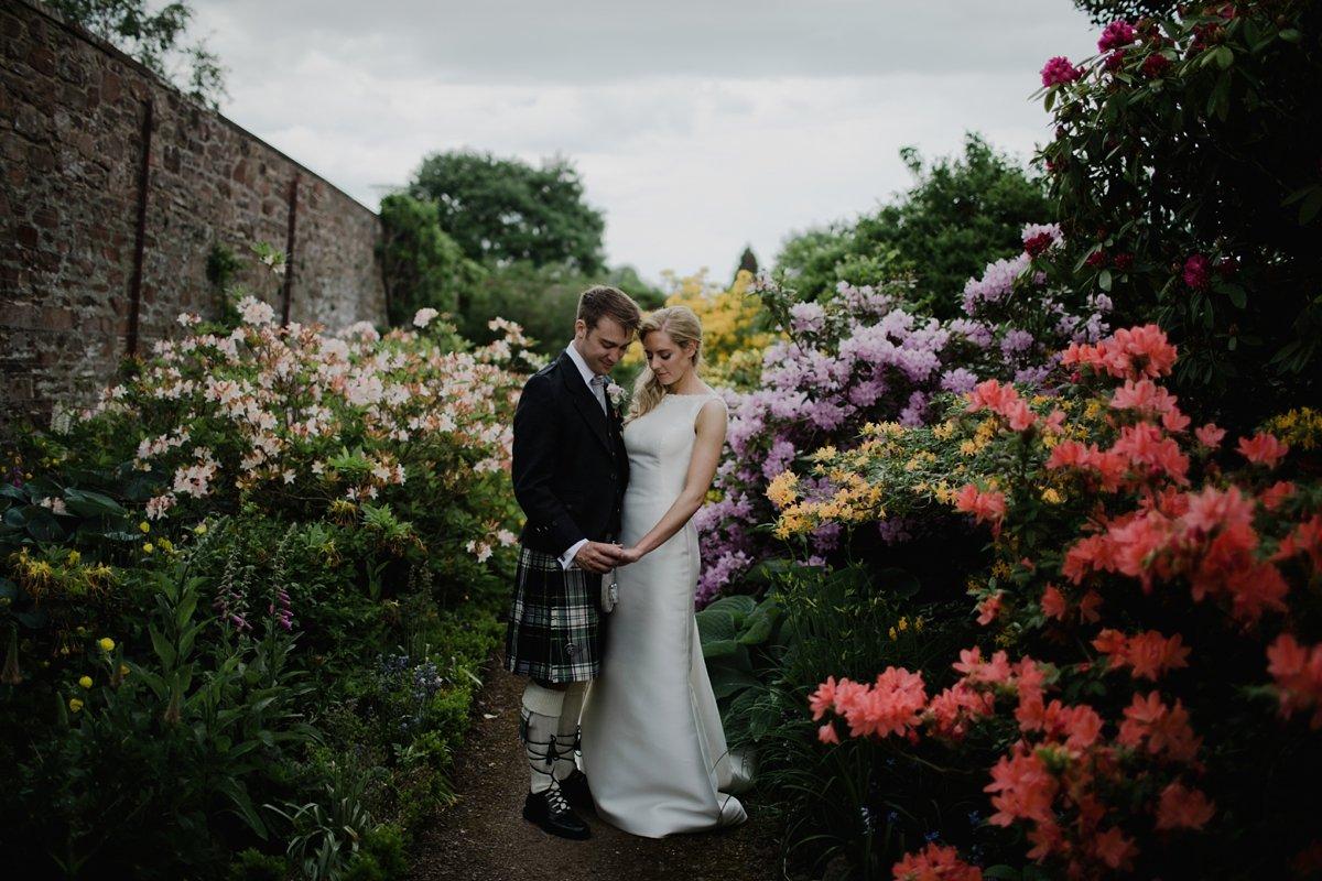 wedding couple portraits at harmony house garden wedding