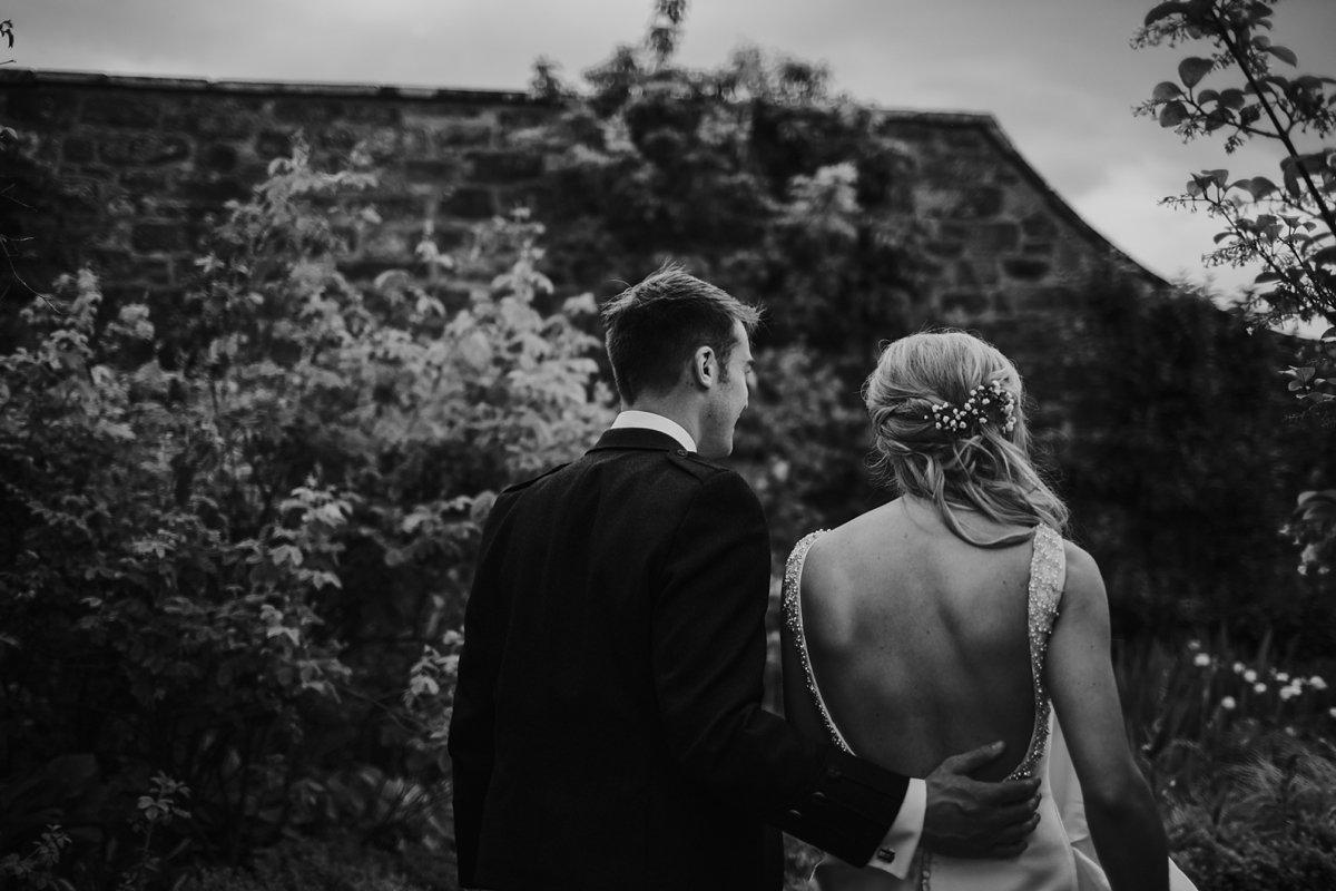 wedding couple exploring harmony house gardens