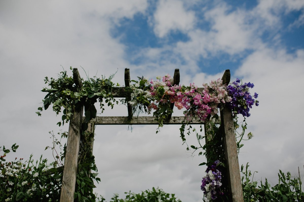 flower arch for garden wedding ceremony