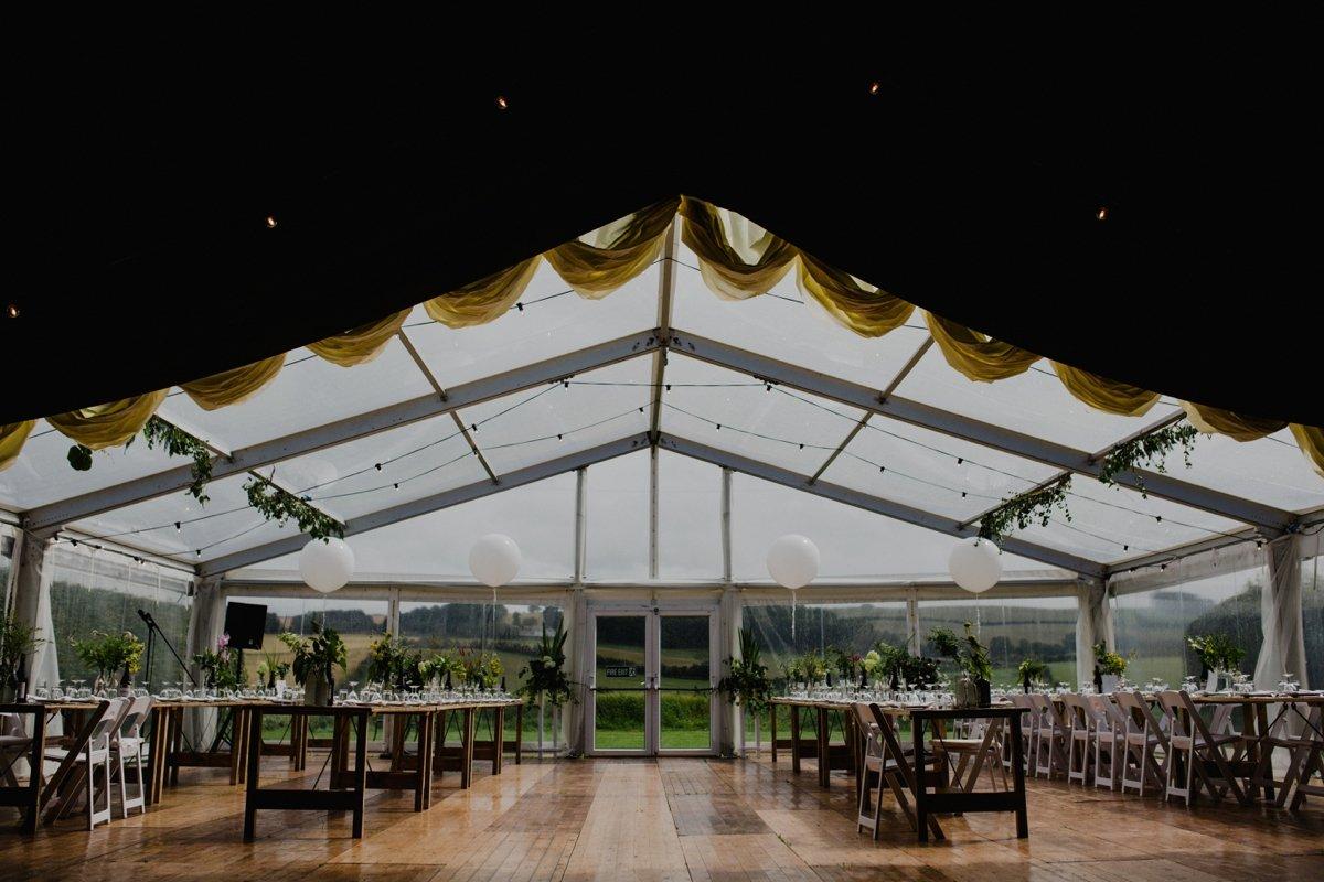 clear span marquee setup for wedding reception garden wedding