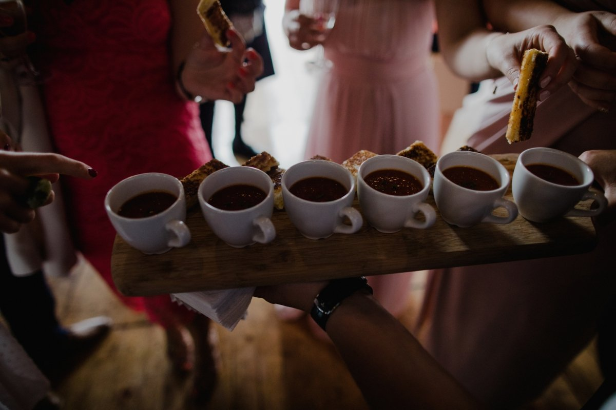 wedding caterers pantry serving up mini cups of soup