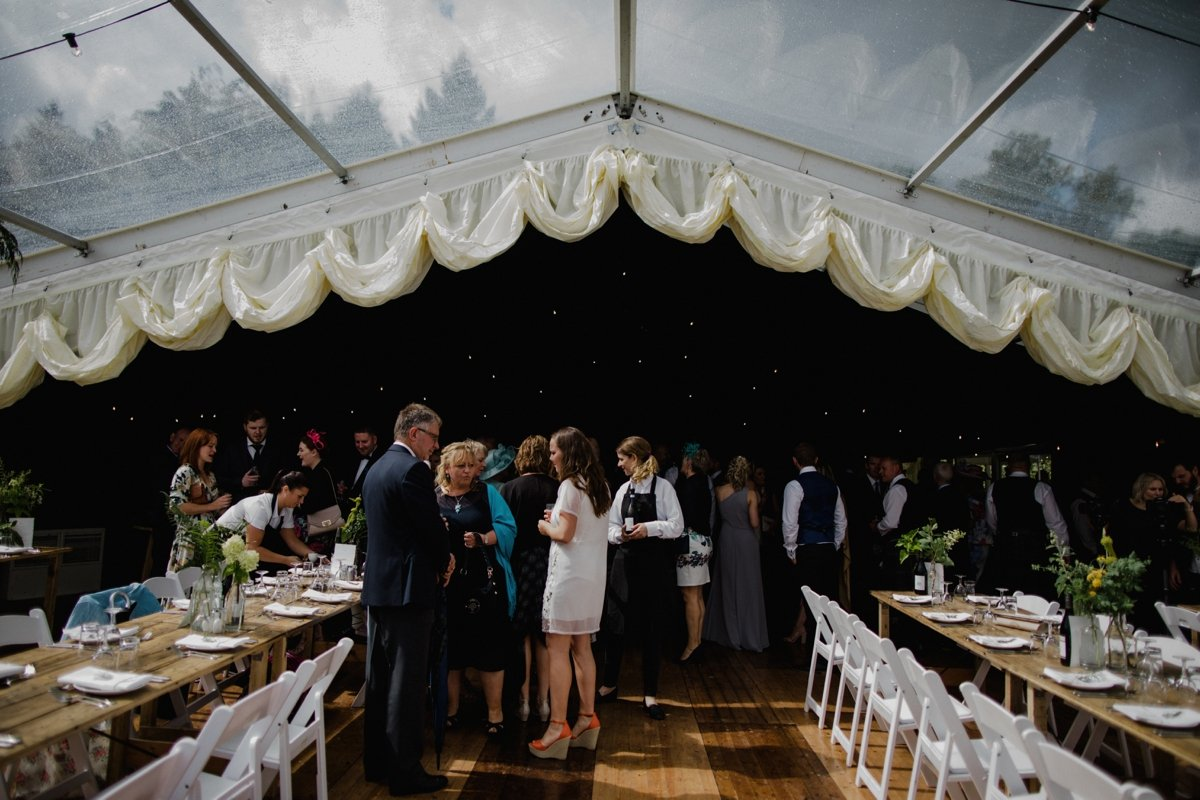 view of guests in the clear span marquee