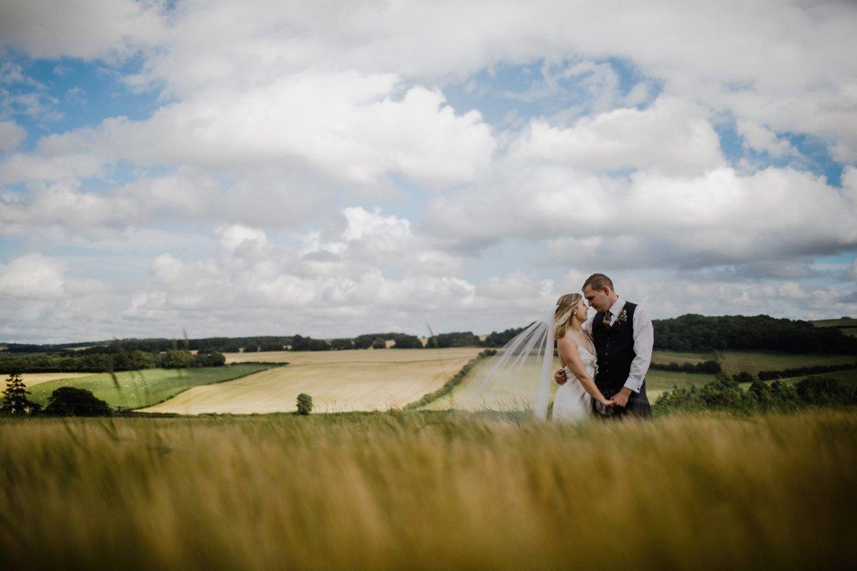 bride and groom in field rustic sunny countryside scottish borders garden wedding