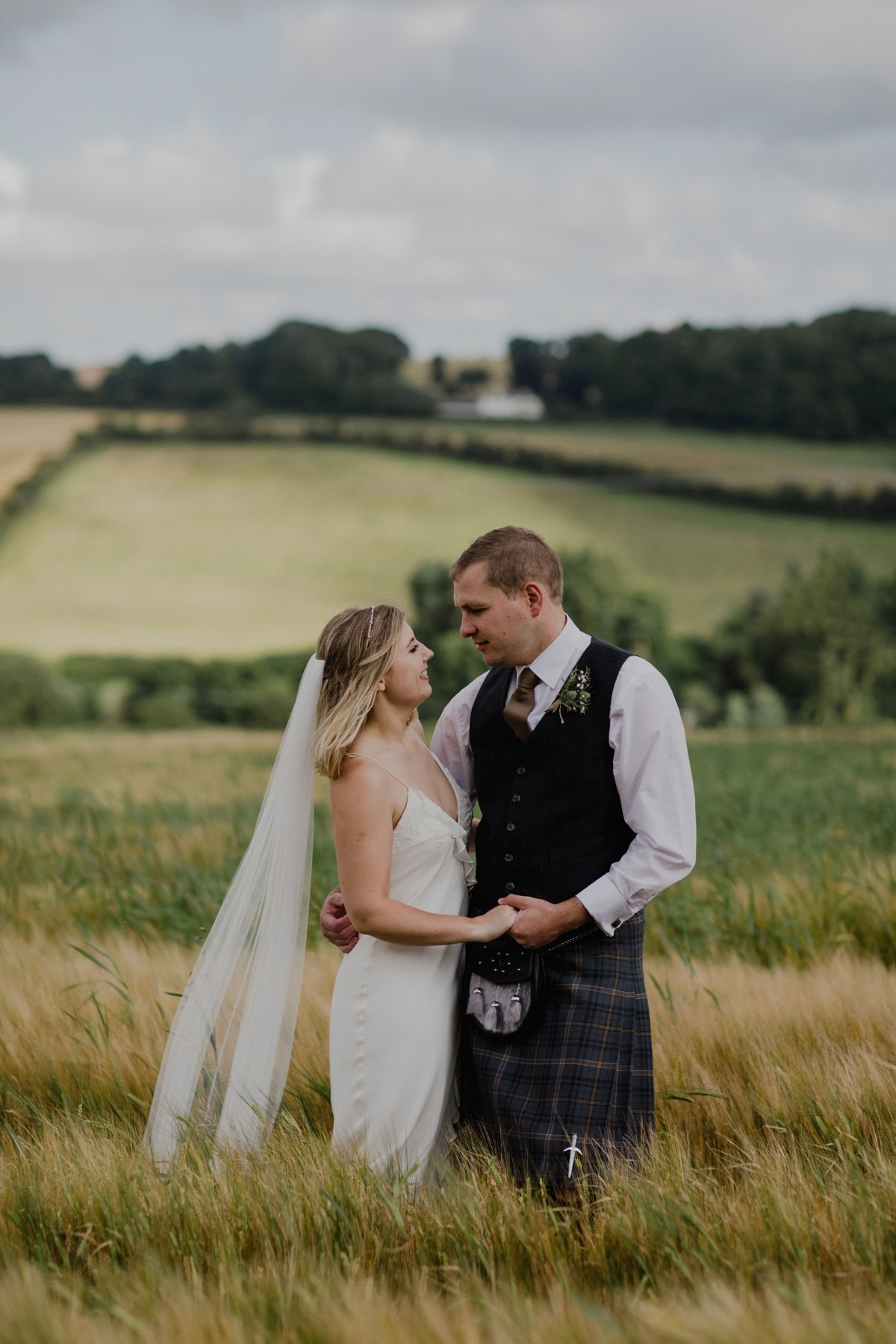 bride and groom portrait in field rustic countryside scotland