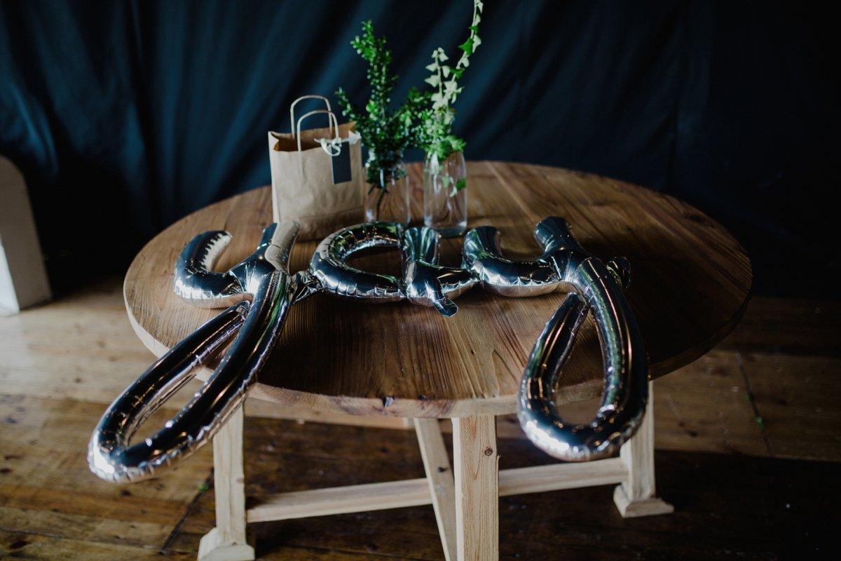 yay silver balloon sat on rustic wedding table marquee wedding