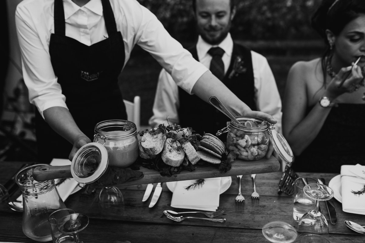 guests being presented with grazing platter from the pantry catering in the scottish borders