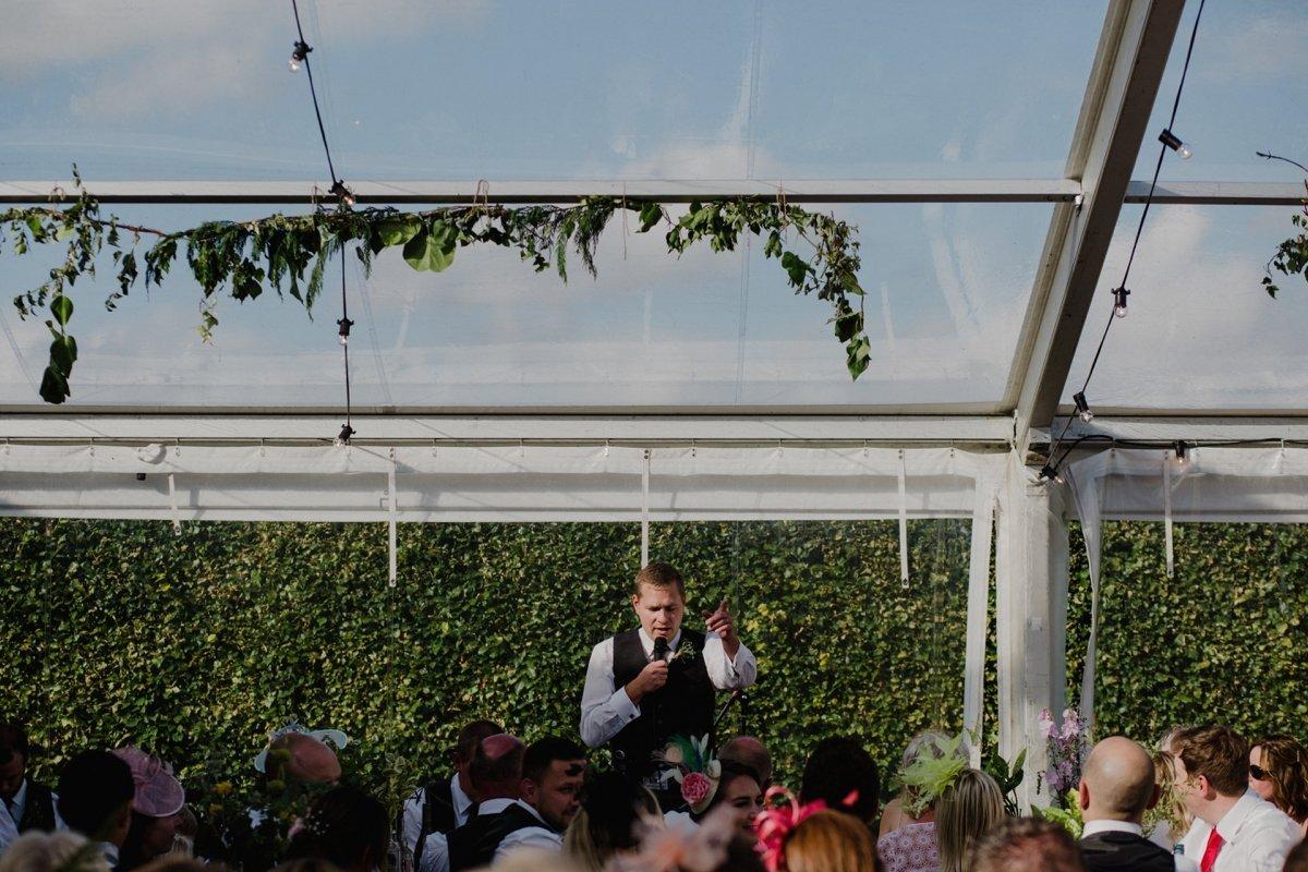 groom giving a speech clear span marquee garden wedding
