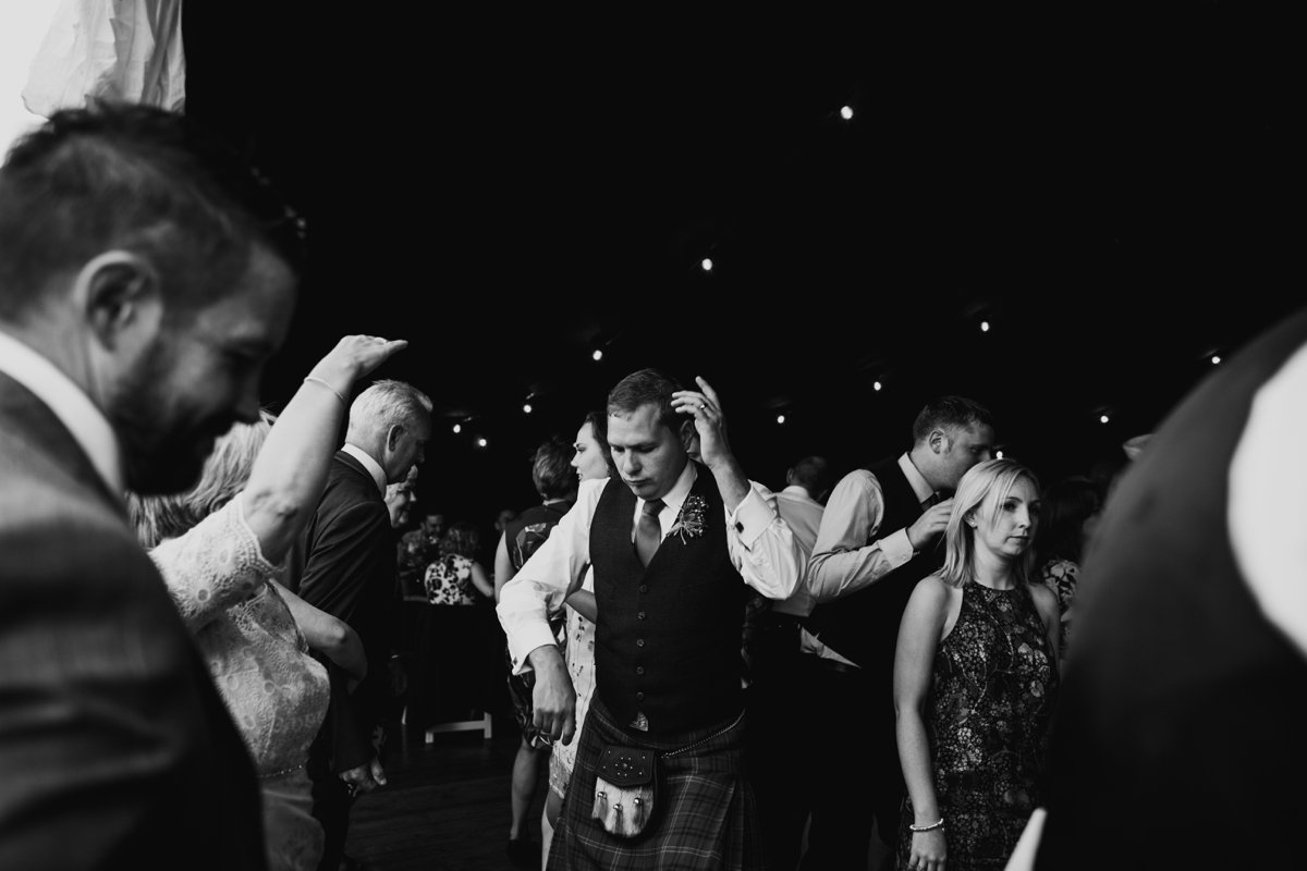 groom dancing with guests marquee wedding