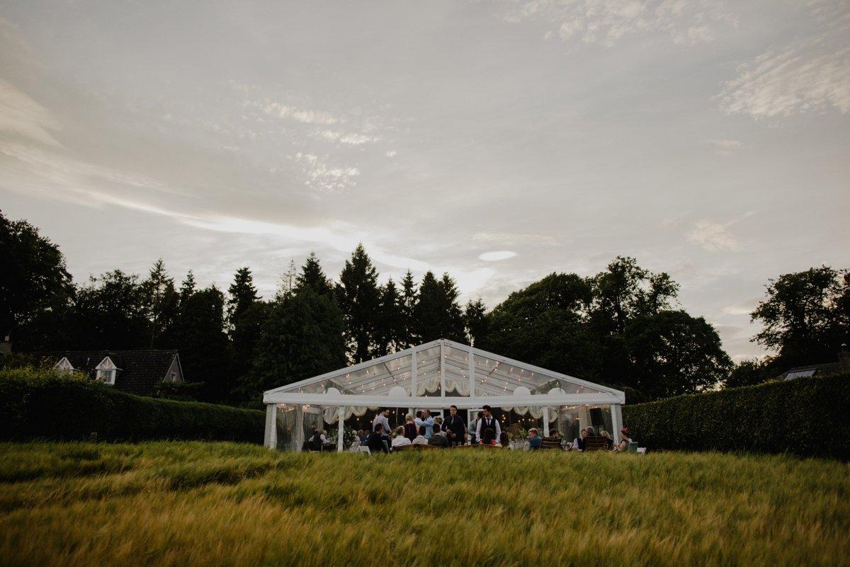clear span marquee evening garden wedding