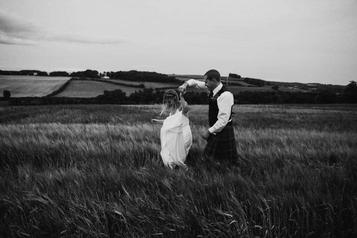 bride and groom dancing in field scottish borders garden wedding