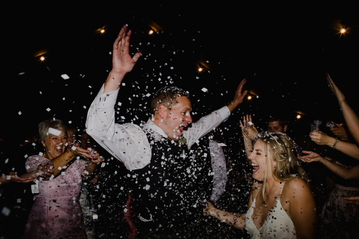 bride and groom confetti on dancefloor marquee garden wedding