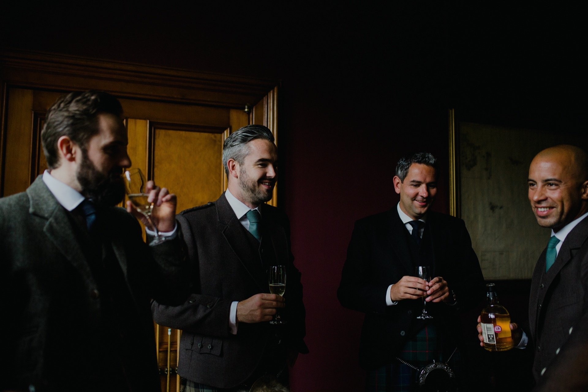 groom and groomsmen in the billiard room at cambo house
