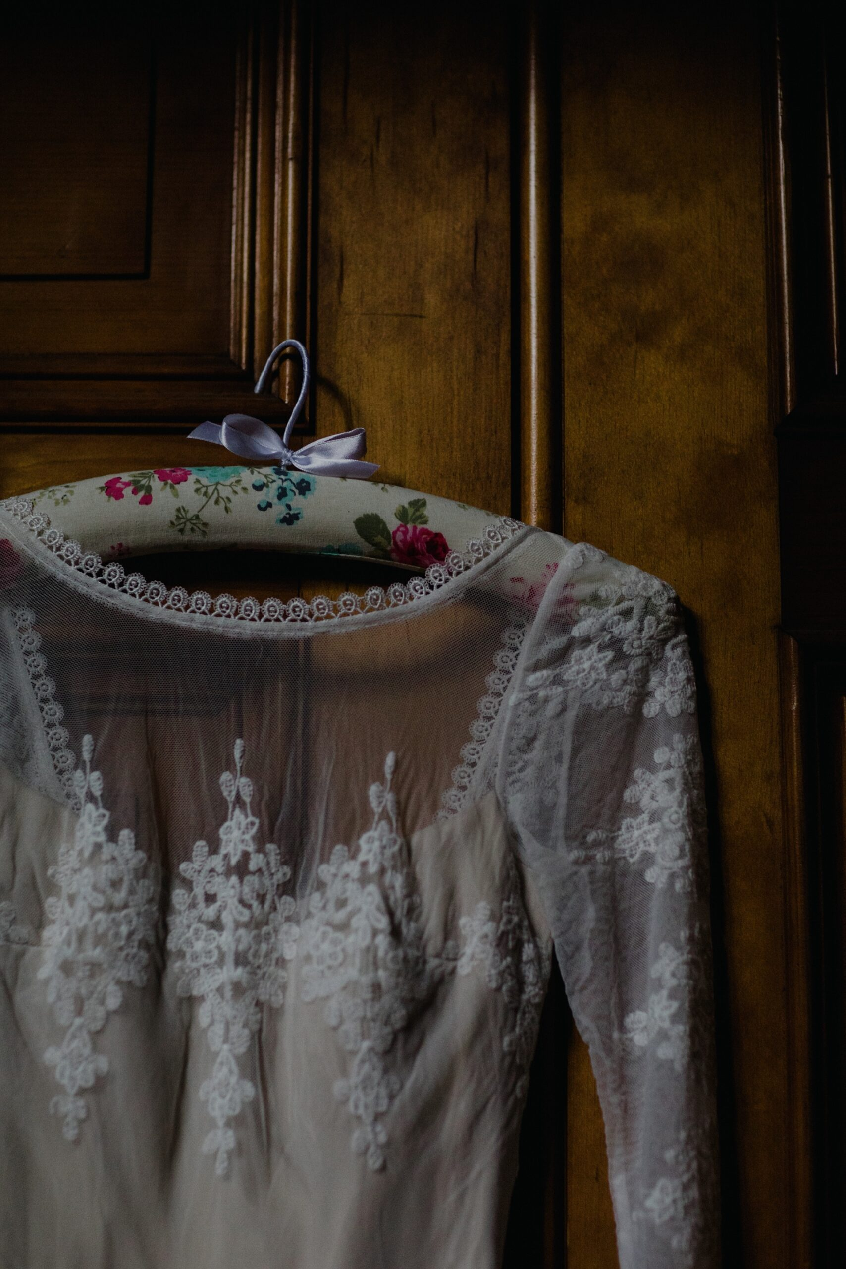 closeup detail of dreamers and lovers wedding dress hanging