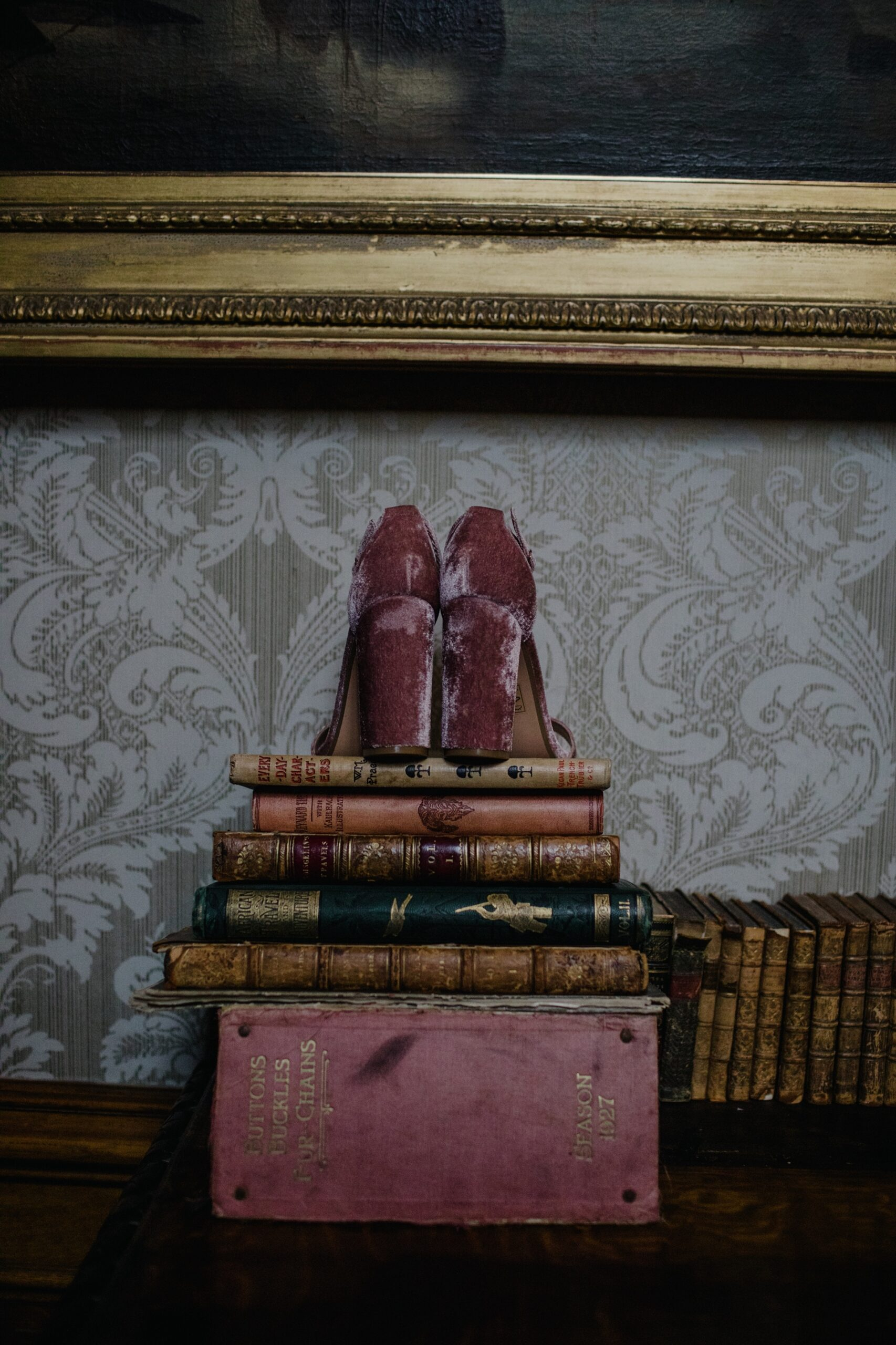 pink velvet shoes on books in cambo house