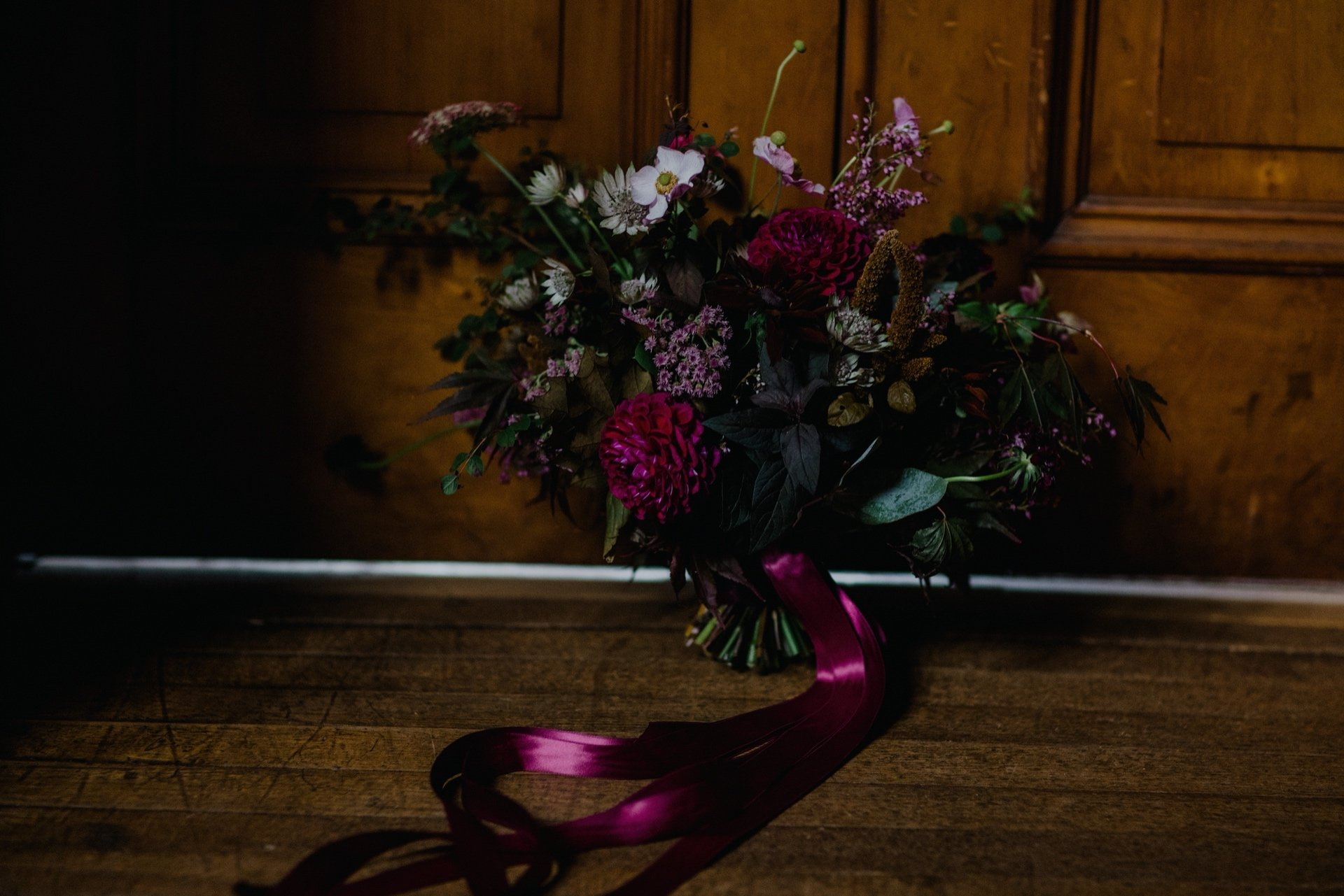wild romantic autumn bouquet with red ribbon
