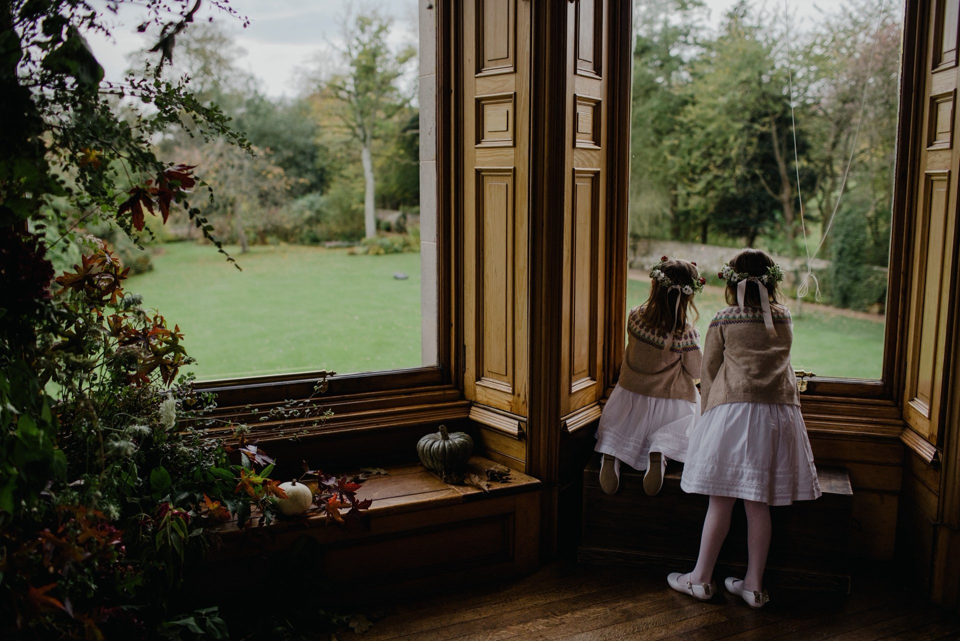 Flower girls looking out the window at cambo house