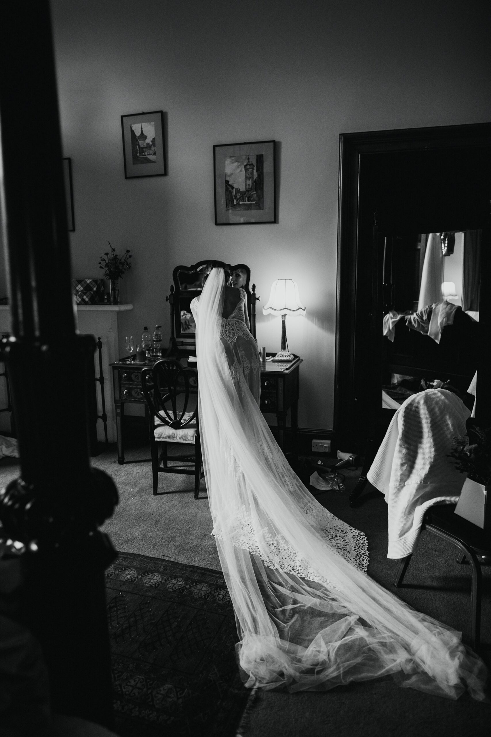 bride doing her final touches before her wedding ceremony at cambo house