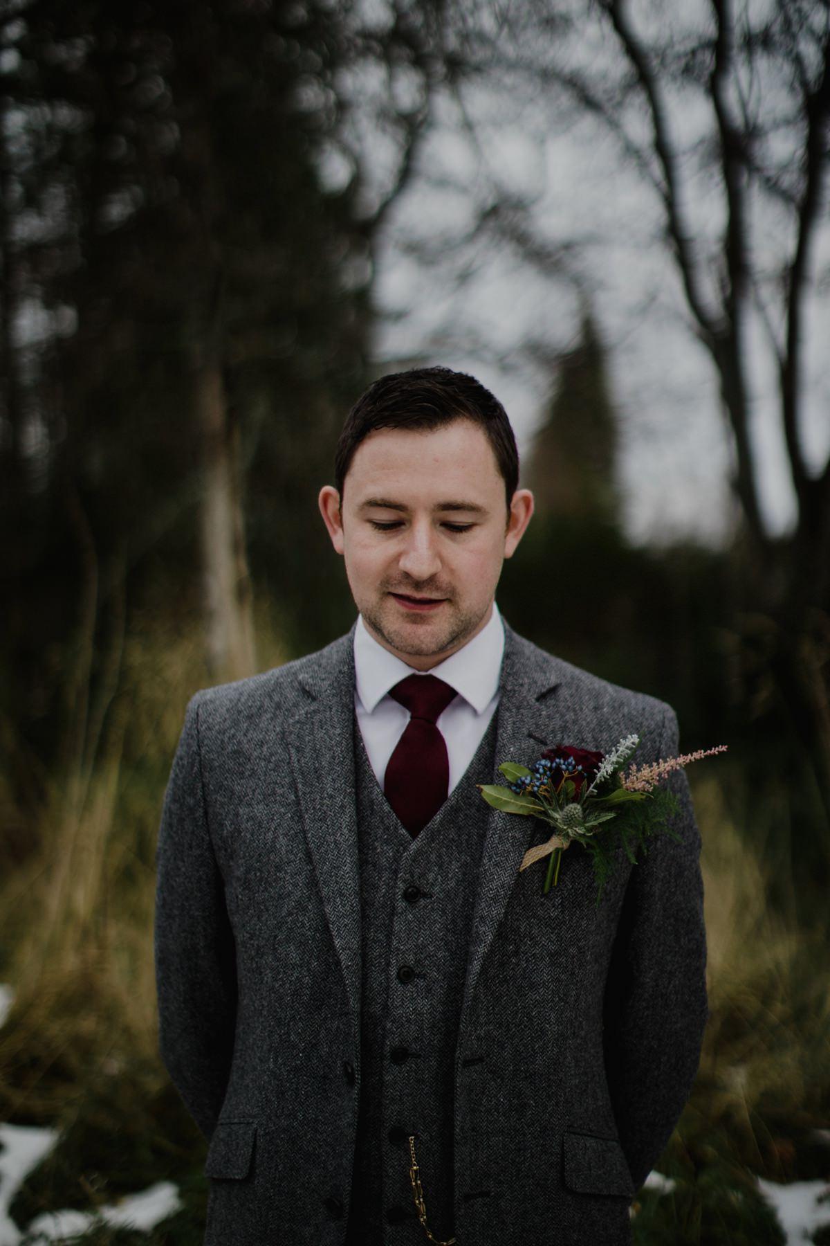 Portrait of Groom outside wearing tweed suit