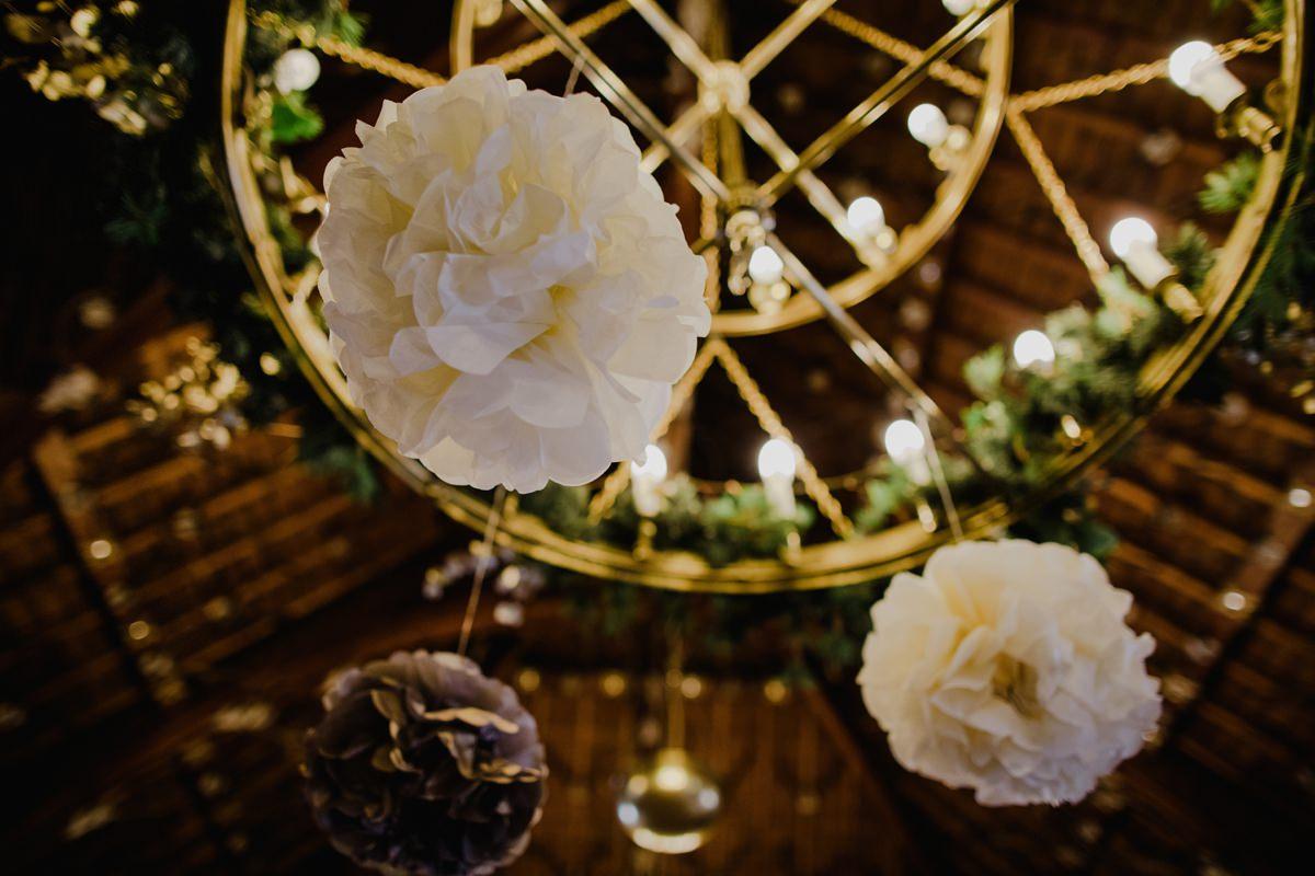 Paper pom-poms decorate the chandelier at Glen Tanar Ballroom