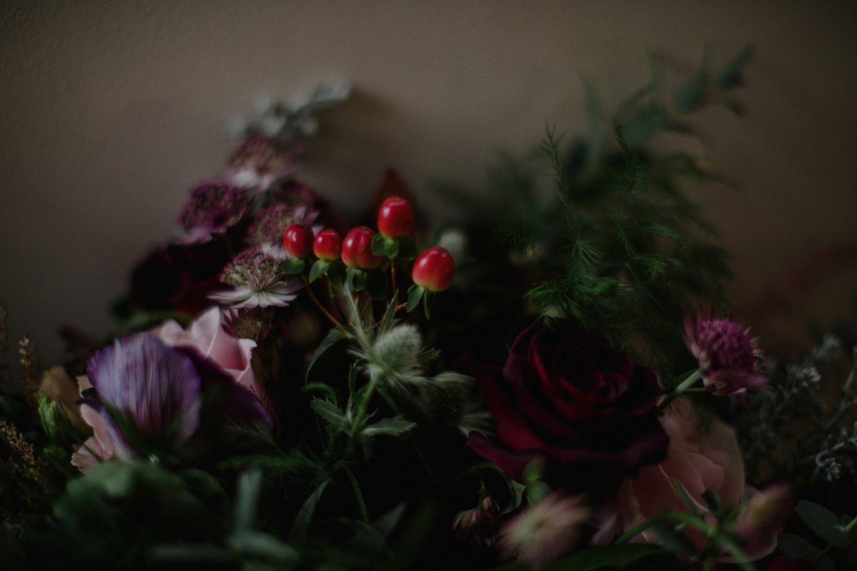 Berry detail of bride's bouquet