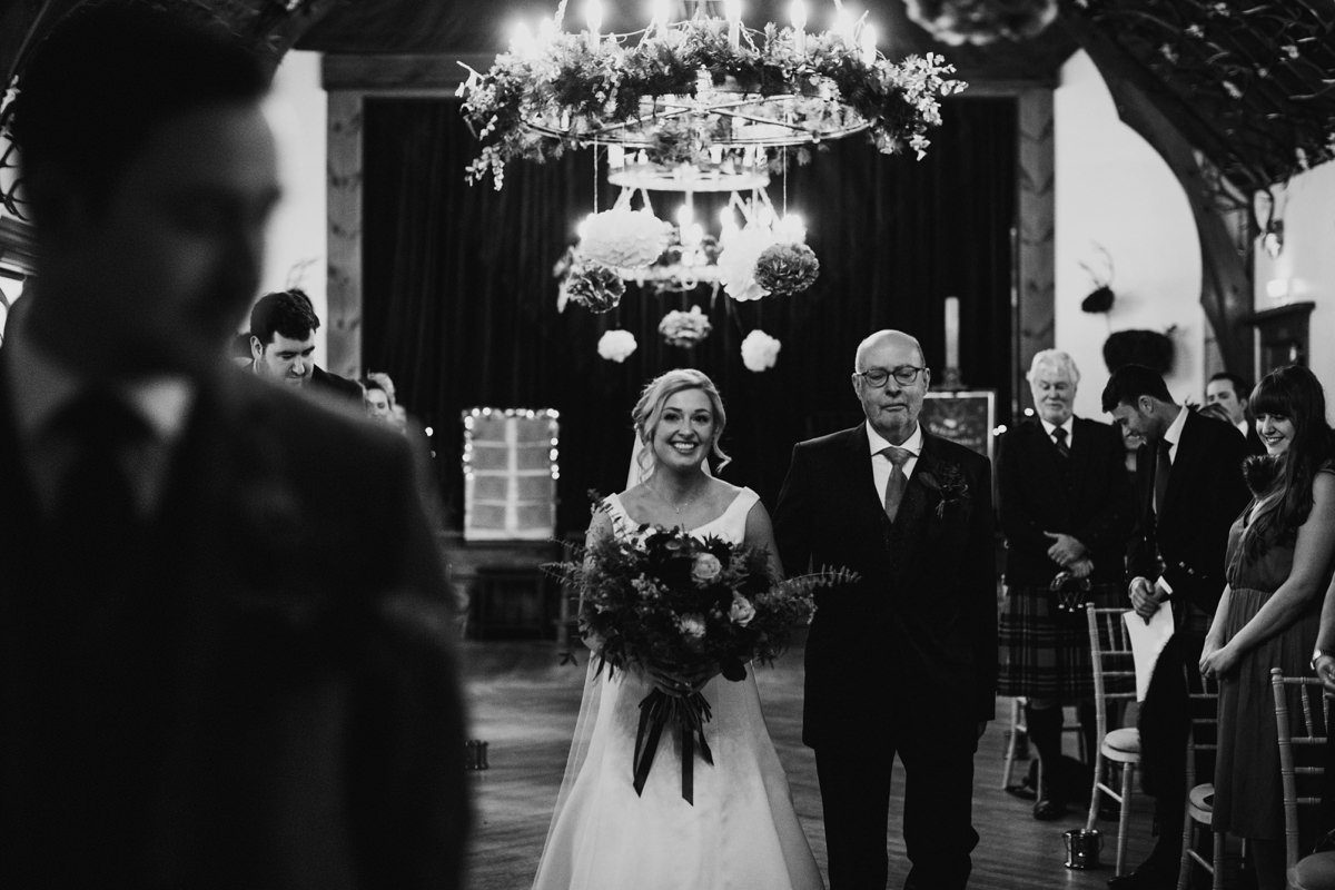 Bride walking up the aisle with her father