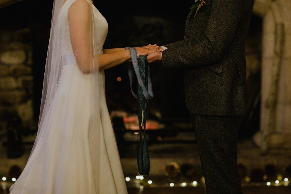 Wedding couple handfasting at Glen Tanar Ballroom