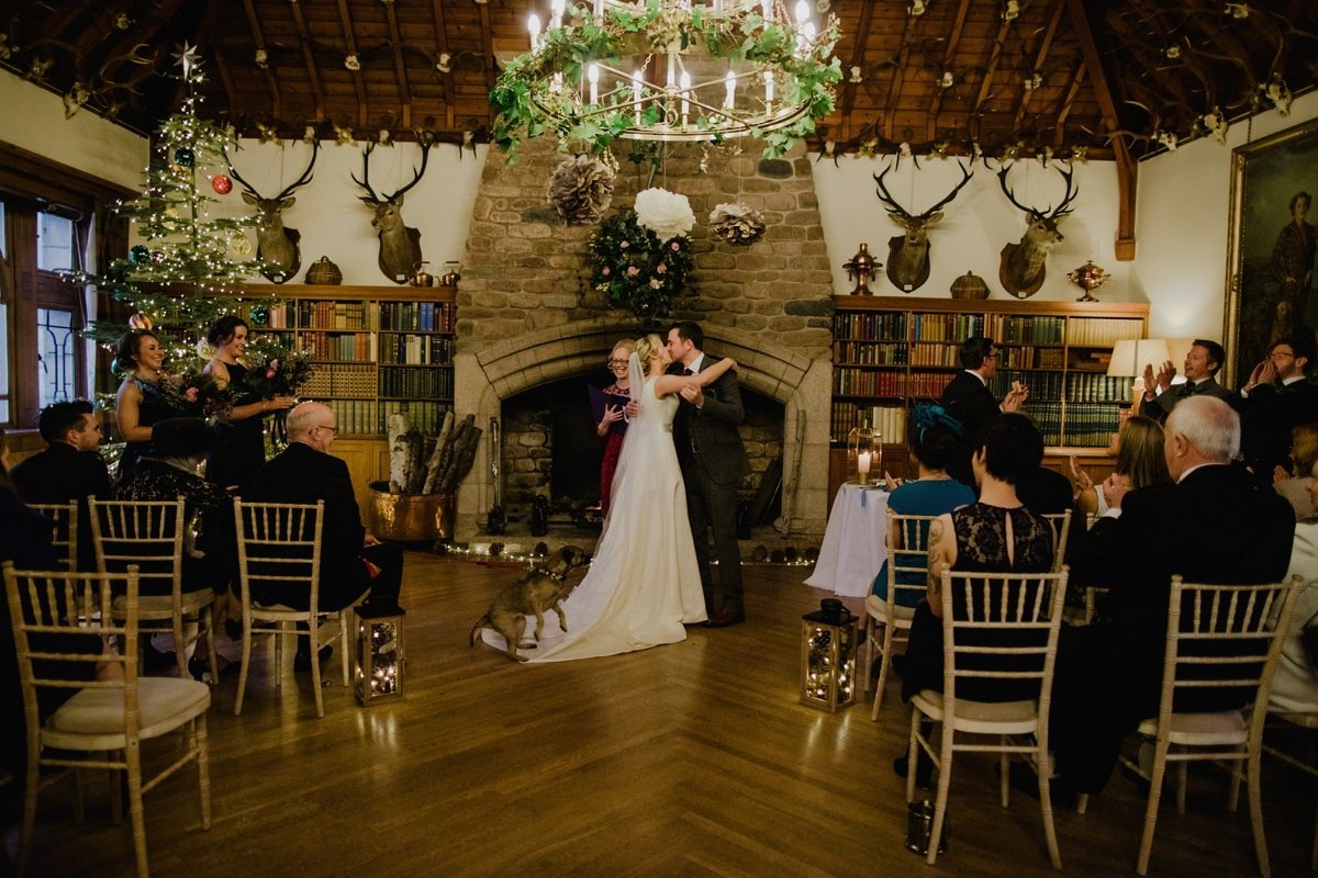 bride and groom having first kiss at during their ceremony Glen Tanar Ballroom