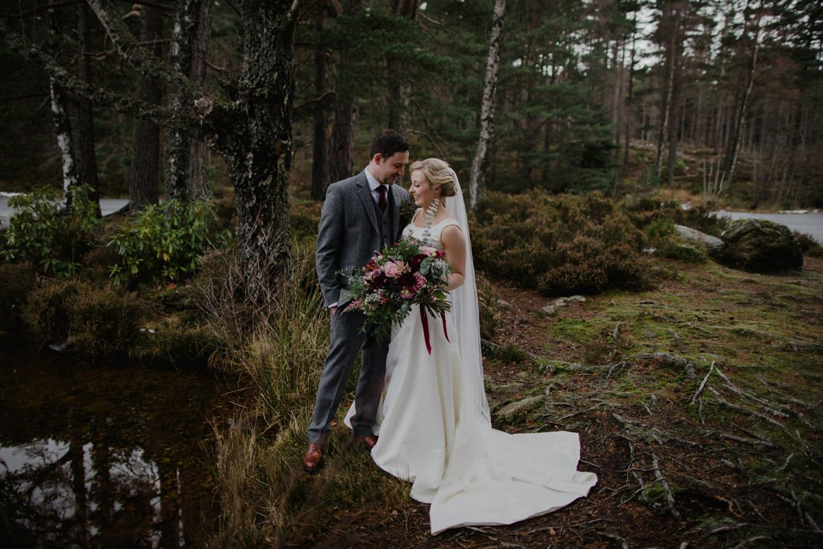 Bride and Groom portrait by the loch at Glen Tanar