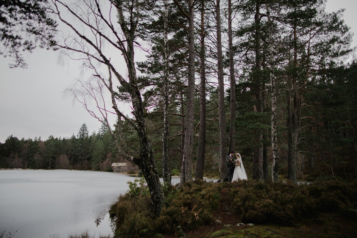 Bride and Groom in the woodland at the lochside at Glen Tanar