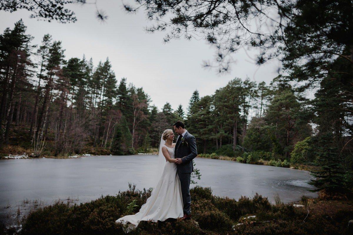 Bride and Groom portrait at the lochside in winter at Glen Tanar Ballroom