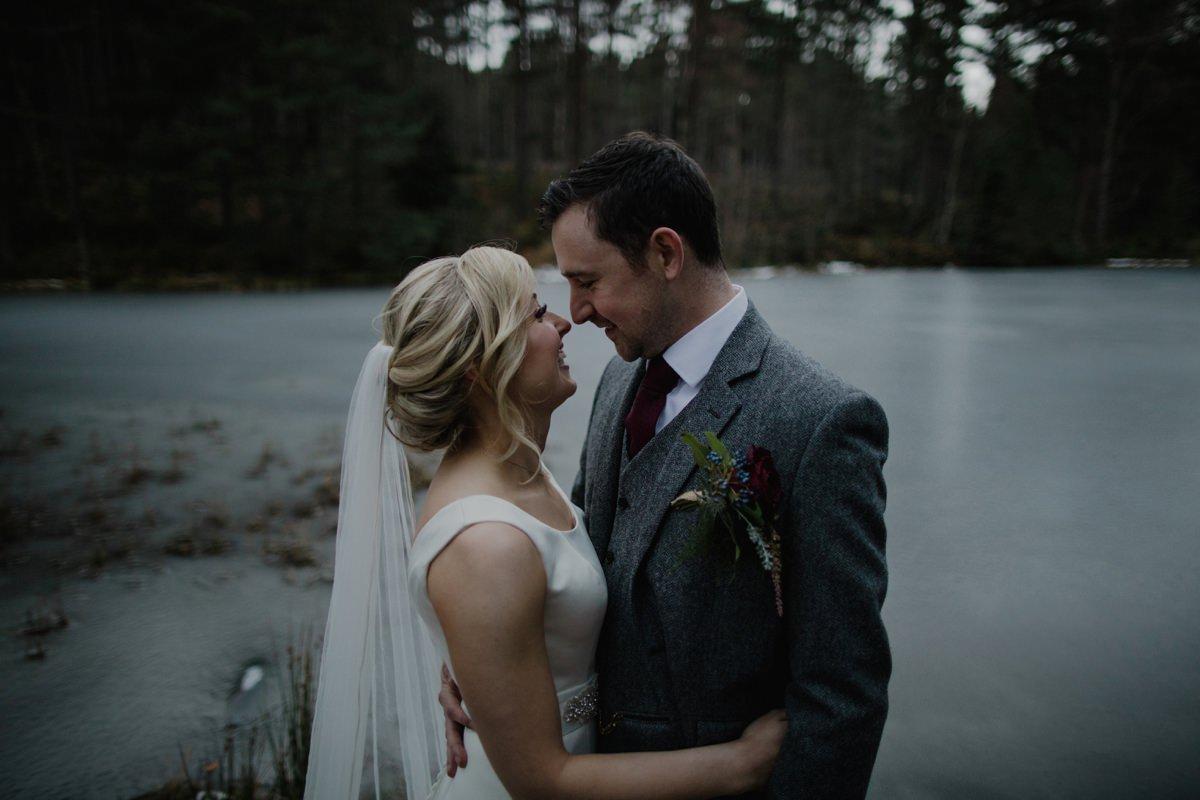 Moody couple portrait by the frozen loch at Glen Tanar Ballroom