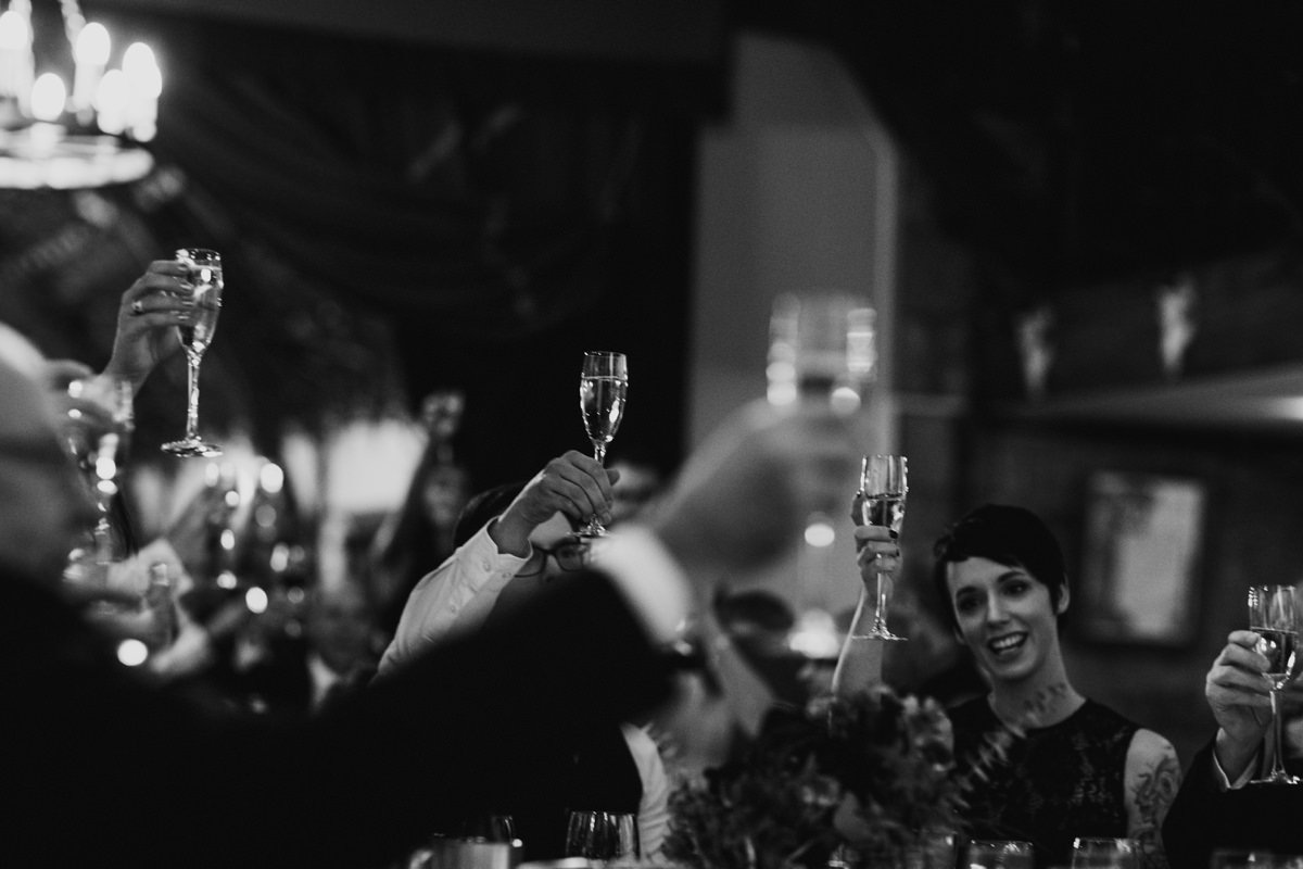 Guests raising their glasses during the speeches
