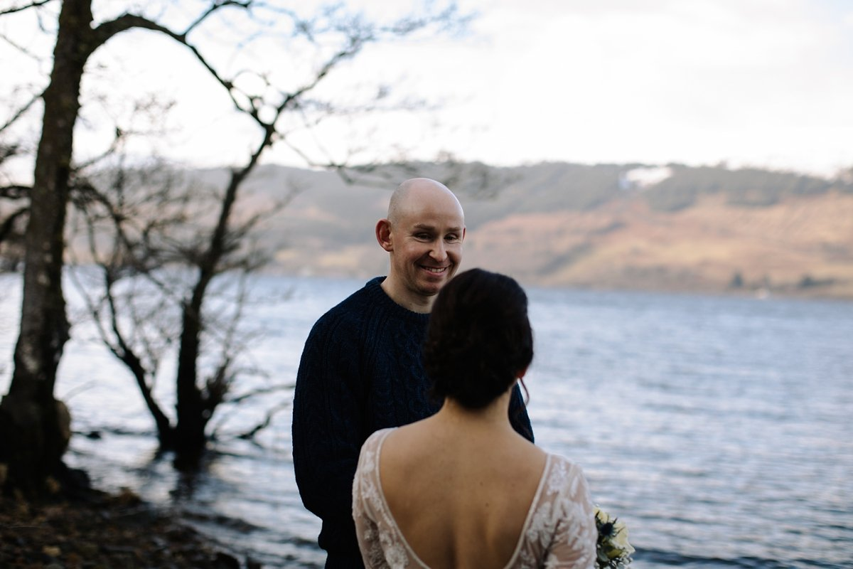 Groom smiling after seeing his bride arrive