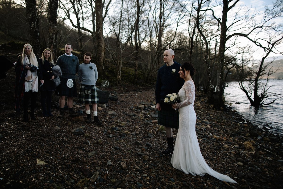 Bride and groom with guests during the outdoor ceremony