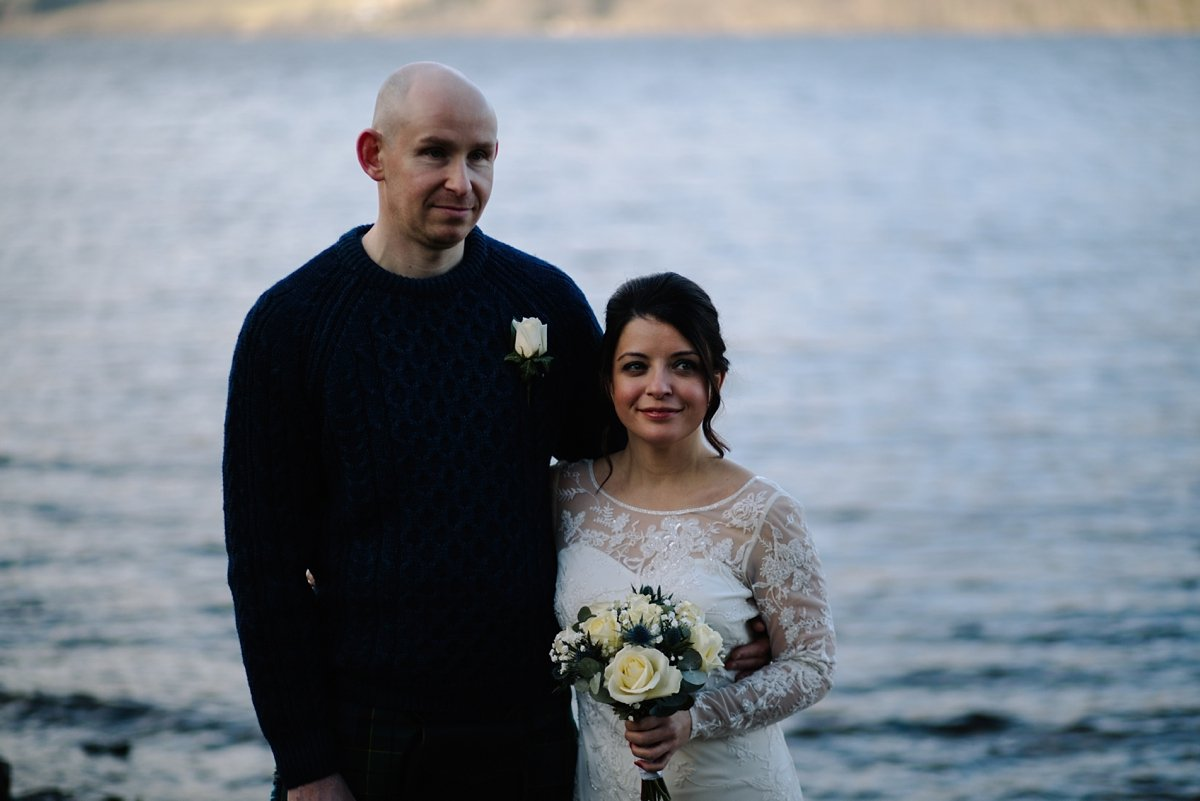 Bride and groom in front of Loch Tay during their ceremony