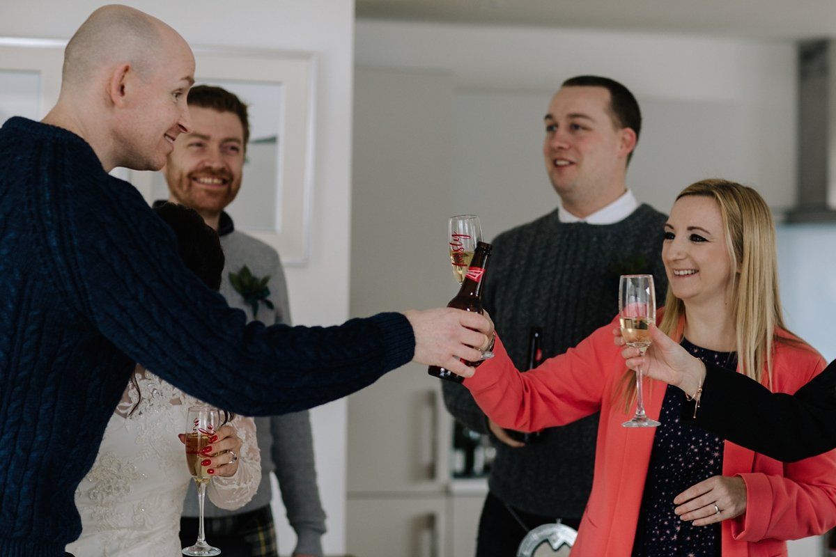 guests toasting to the happy couple