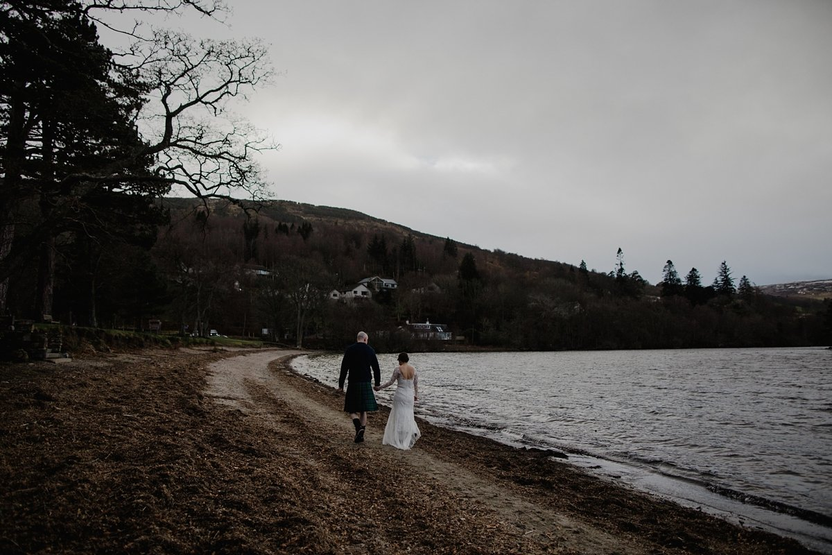 bride and groom walking on the beach at kenmore