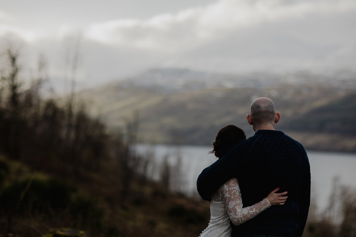 bride and groom looking out over loch tay