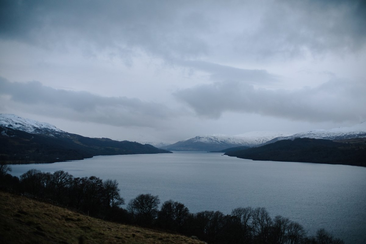 atmospheric snowy view down loch tay from the road