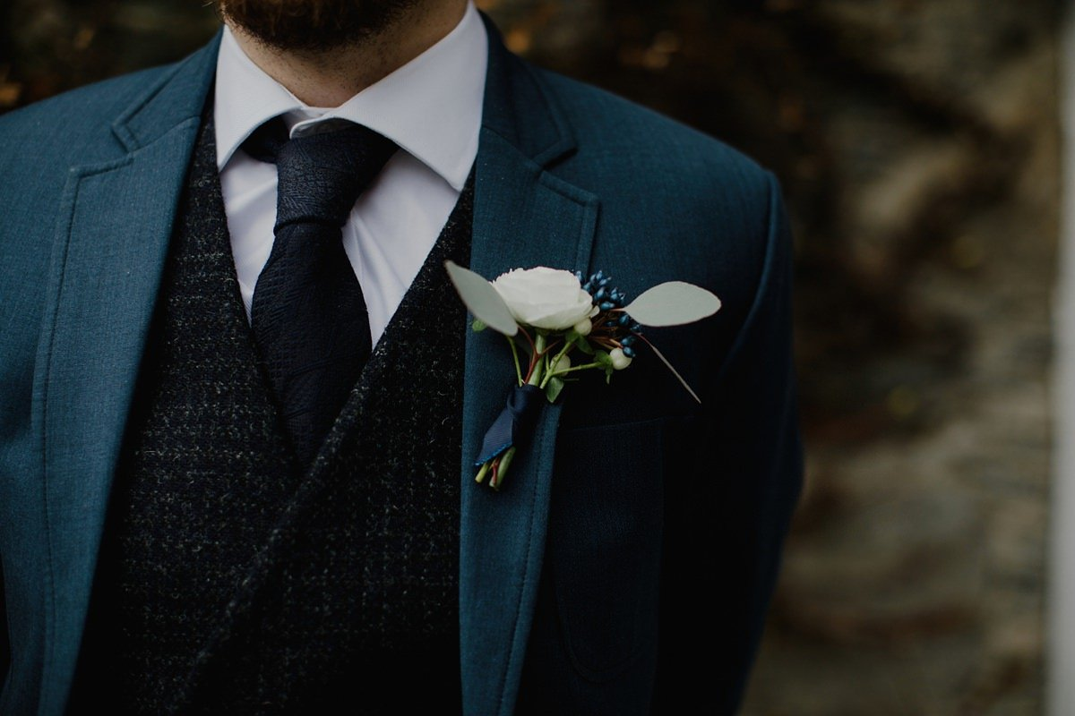 detail of groom's buttonhole and jacket detail