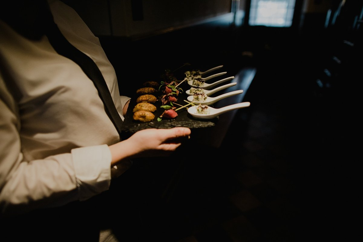 waitress holding delicious looking monachyle mhor canapes
