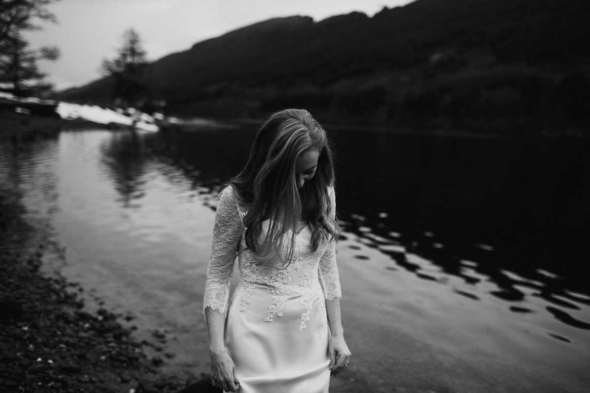 black and white of bride on the lochside