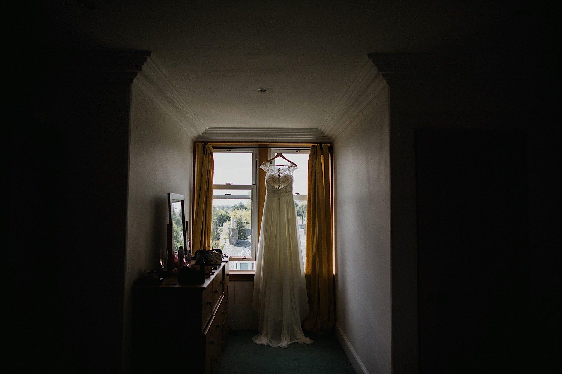 wedding dress in window of bride's home
