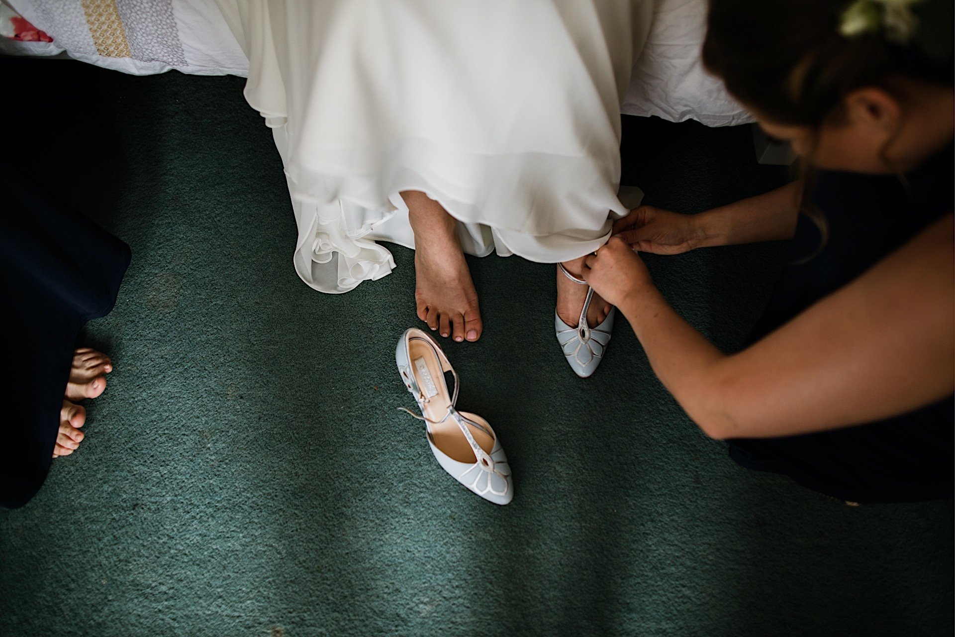 putting bride simpson shoes on Rachel