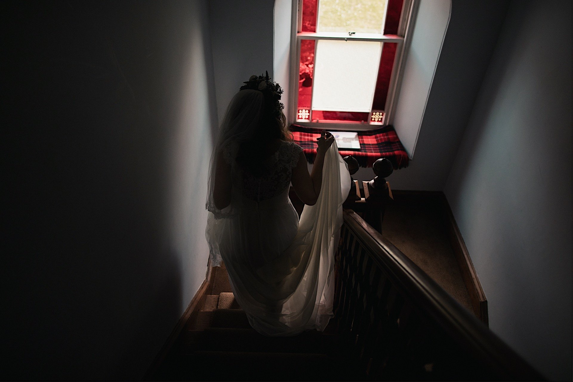 bride coming down stairs in her home
