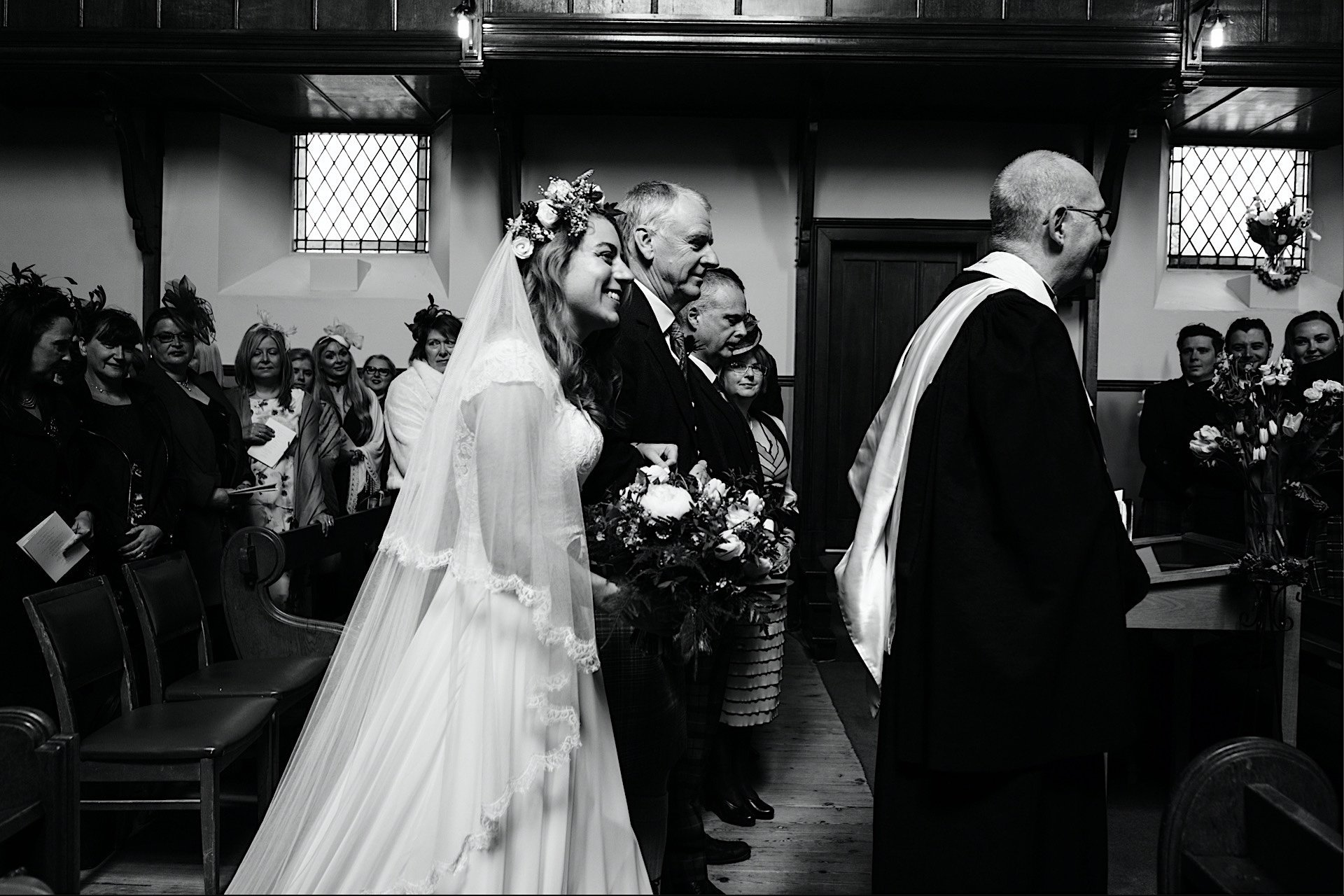 bride Walking with father up the aisle of the church