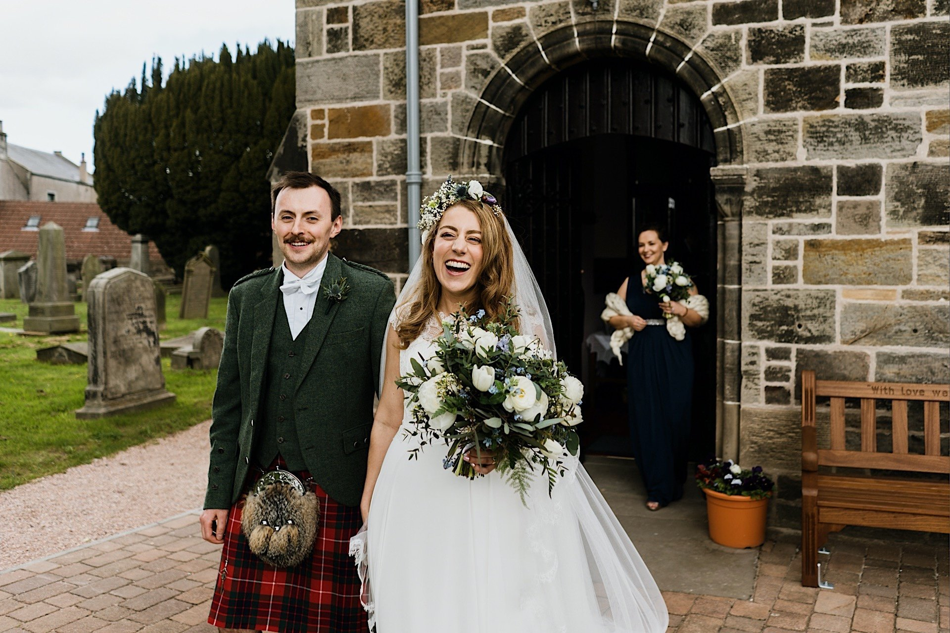 church bride and smiling as leave the groom they