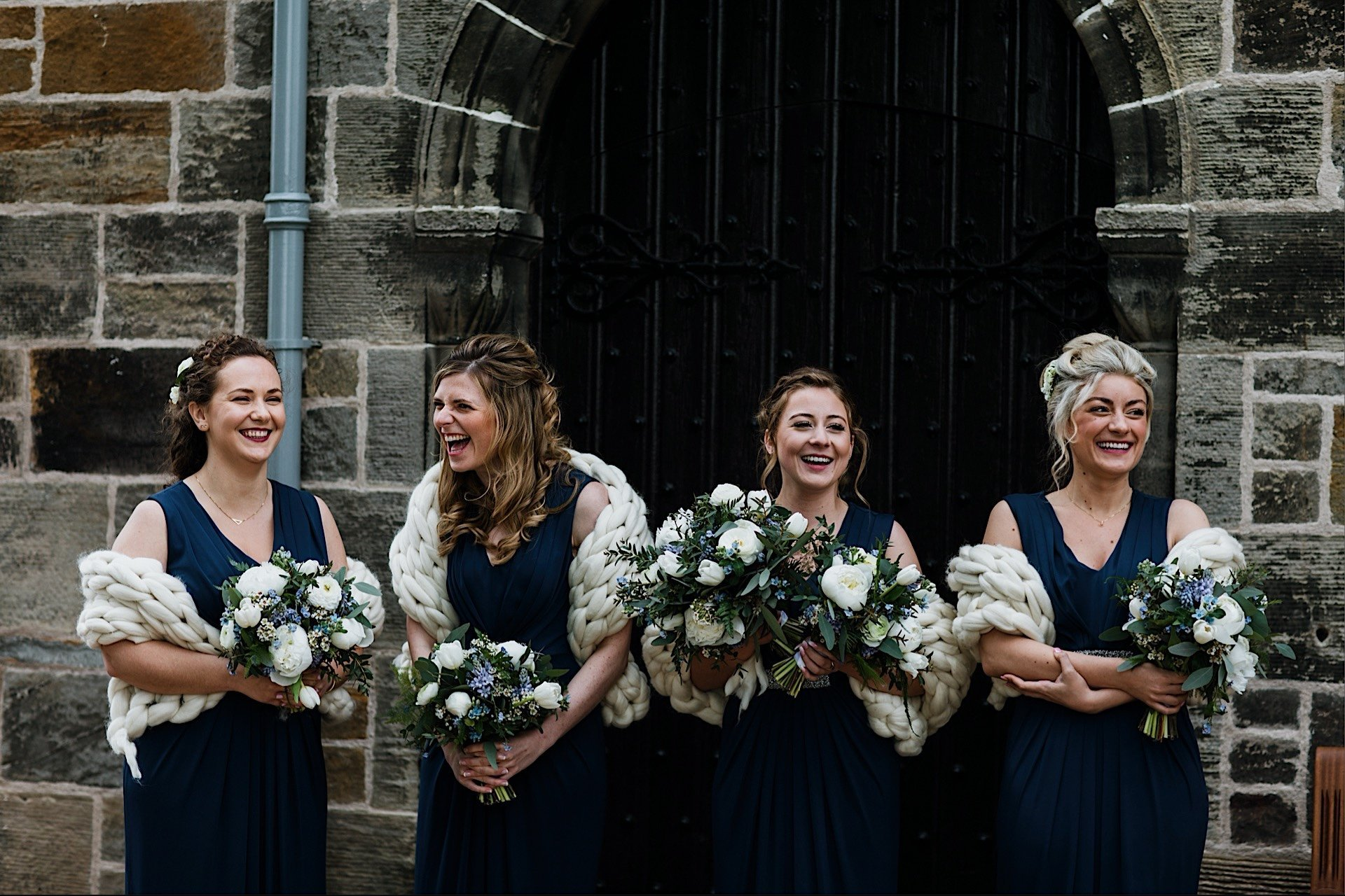 knit blue shawls bridesmaids navy dresses chunky laughing Wearing and cream outside church